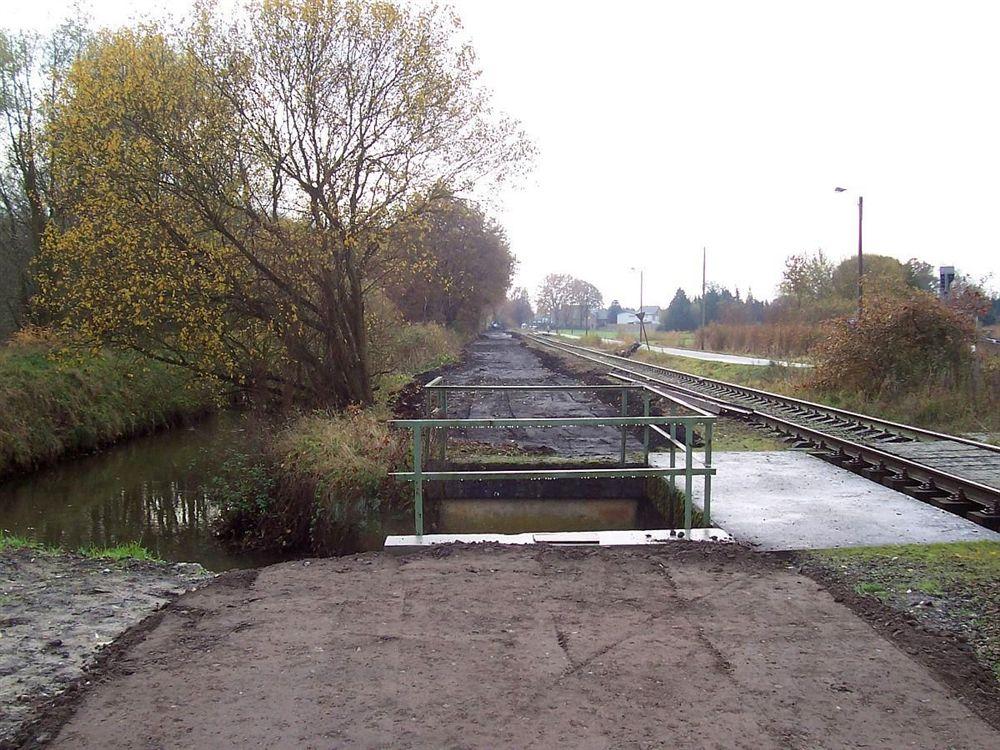 L018 Winterslag - Eindhoven (L18)  - Fietssnelweg Noord-Zuid-As Er-komt-een-fietspad-langs-de-spoorweg